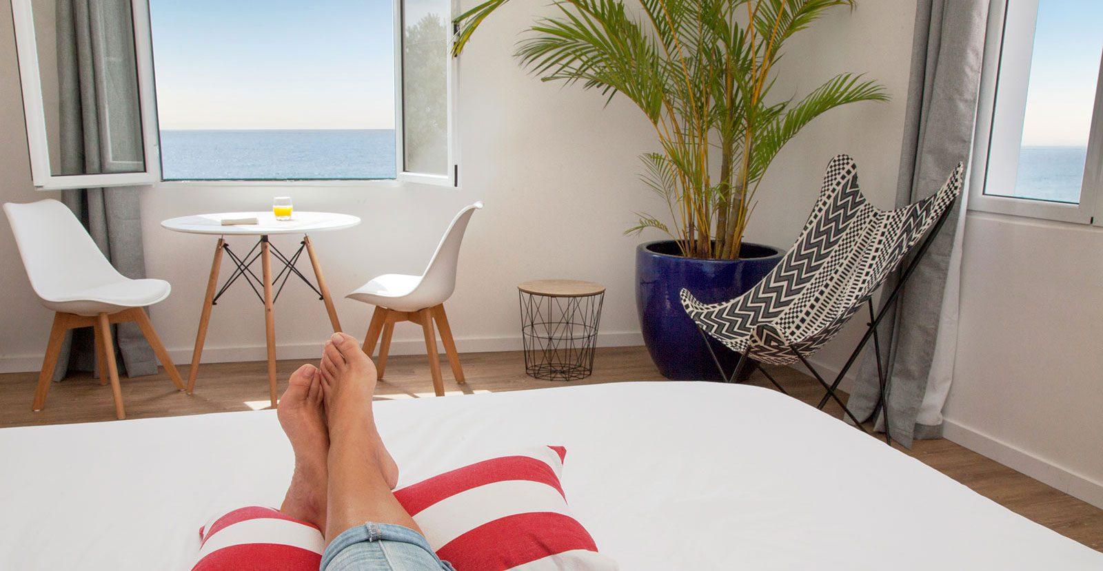 Villa Sal Azores Stays bedroom relaxing with ocean view